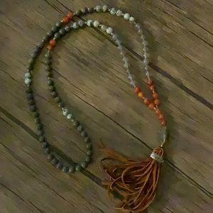 Leather tassel bead.